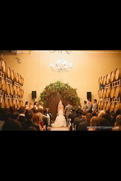 Winery weddings . Barrel room ceremony .