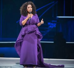 Hitting a purple patch! Oprah Winfrey takes the stage in dramatic ...