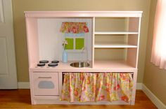 entertainment center turned play kitchen via Tip Junkie