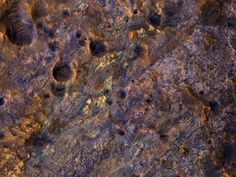 "Fantastic: This image (taken by the HiRISE camera on NASA's Mars Reconnaissance Orbiter) covers a exposure of clay-rich bedrock on the ""shore"" of the Northern plains, north of Mawrth Vallis on Mars. The relatively bright areas reveal a complex terrain with a range of textures and enhanced colors. We probably need to send a rover here to understand the complex history of these very ancient deposits."