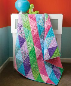 Assemble a colorful baby quilt quick as a wink with this sweet design.