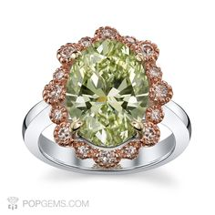 Our Spring time pick... Rare Oval Fancy Chameleon diamond weighing 3.51 carats surrounded by Pink diamonds and mounted on 18k white and rose gold. GIA Certified Natural. #green #diamond #diamonds #ring #oval #spring #greendiamond #chameleon #luxury #popgems #pinkdiamond