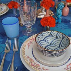 Asian table setting that makes carnations look like a million. By Miles Redd.