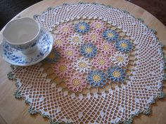 """Made with heavier yarns, this would be a cute rug. """"Hand crocheted doily"""
