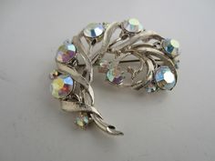 Floral Brooch Pin AB Crystal Detail Silver Tone Metal Curved Design Vintage