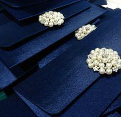 Shagun envelopes. Adore those brooches.