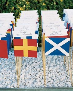 On the day of the wedding, flags donned the buildings surrounding the cathedral, and loyal citizens even waved American flags to honor the new princess as they stood outside. We like the idea of honoring an international nautical theme by incorporating mini flag escort cards. Source