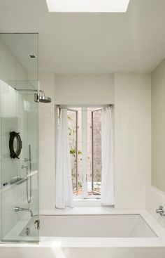 patterned tile floor, shower/tub combo with 1/2 wall of glass, no ...