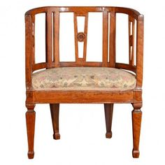 "Neo-Classical carved mahogany armchair with open slat back, decorated with carved medallion rosettes, Italy mid 19th century. Height 33"" Width 24.5"" Depth 19"""