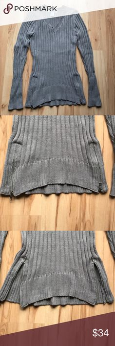 Gray Sweater with Zippers Size M. Two zippers in front at bottom. Chest 15in. Waist 12.5in. Length 26in. Sleeve 25in. Sweaters V-Necks