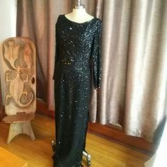 Elegant and timeless long sequined dress! Black, long sleeved, split on both sides.  Perfect for black tie affair.  Worn once and in excellent condition. scala Dresses