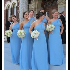 Spotted on Facebook: long, blue, one shoulder bridesmaids dresses. Very pretty!