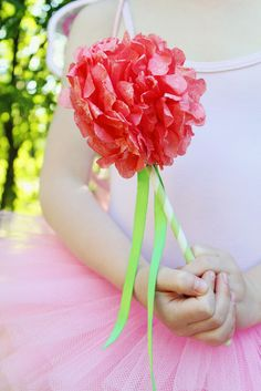 small pom + stick/ribbon