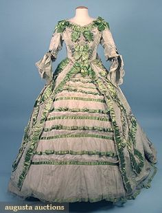 1850-1890 two-piece floral printed mint green silk chine, trained Watteau back, trimmed w/serpentine bands of green satin ribbon w/underskirt of ivory taffeta decorated w/green ribbon trimmed tulle flounces. Via Augusta Auctions.