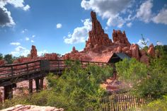 Big Thunder Mountain Railroad (or for short Big Thunder Mountain) is an indoor/outdoor mine train roller coaster located in Frontierland at several Disneyland-style Disney Parks worldwide. Loads of fun and well worth the wait. Opened in 1980 at Disney World