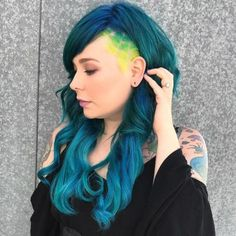 50 Women's Undercut Hairstyles to Make a Real Statement Long Teal Hairstyle With Temple Undercut Undercut Hairstyles Women, Undercut Styles, Undercut Women, Undercut Pompadour, Popular Hairstyles, Hairstyle Men, Medium Hairstyles, Undercut Fade, Undercut Pixie