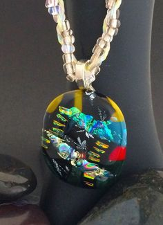 Multi-colored Dichroic Glass Pendant with a Handmade Beaded Cord. - $58.61 USD