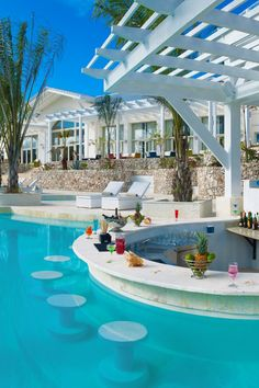 The resort's 34 villas are positioned along a winding lagoon with a swim-up bar. #Jetsetter