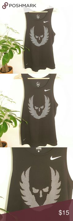 Nike Dri-Fit Running Tank Size Small Nike Dri Fit Running Tank - Size Small  Excellent Condition  Lightweight  Loose Fit  Perfect for running and working out - pair with running or compression shorts ! Nike Tops Tank Tops