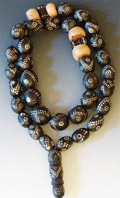 Beautiful strand of Black Coral from Yemen. Yemen silver smiths have a long tradition of nailing tiny silver nails into black coral beads, and these are excellent examples of that art form. The beads Ethnic Jewelry, Coral Jewelry, African Jewelry, Western Jewelry, Bohemian Jewelry, Beaded Beads, Beaded Jewelry, Handmade Jewelry, Punk Jewelry