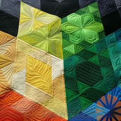 """I swoon over the utterly gorgeous machine quilting on this """"Gravity Quilt"""" by Angie and Quilted by Natalia Bonner of Piece N Quilt. Click through to see more close-ups of Natalia's quilting on this beauty! Pattern by Jaybird Quilts is available here: http://www.fatquartershop.com/gravity-block-of-the-month-quilt-book:"""