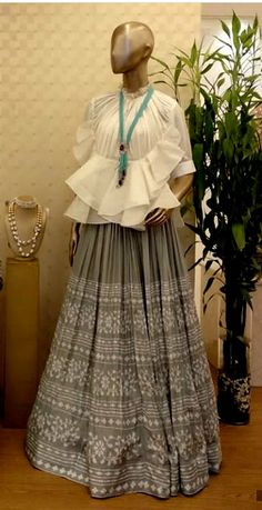 Order contact my whatsapp number 7874133176 Top with ruffles and with different silhouettes with embroidered skirt. Choli Blouse Design, Choli Designs, Lehenga Designs, Blouse Designs, Western Dresses, Indian Dresses, Indian Outfits, Indian Designer Outfits, Designer Dresses