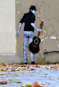 Amazing street art in Paris (with pasted figures) by Charles Leval