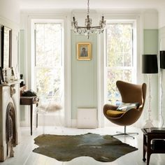 Soft Mint blue green walls become a neutral to the striking mix of antique and modern furniture.