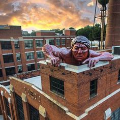 He can almost see the weekend... Keeping an eye out from atop the Lucky Strike building in Richmond, VA. | Photo by @creativedogmedia #dronesdaily #drone #aerial #RVA #richmond #visitva #architecture #travel #gopro #sunset #humpday #VA #usa