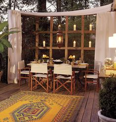 """Wow' to that outdoor eating area! Love the rug and interesting use of candles. Perfect place for Candle Impressions Outdoor Flameless Candles!"