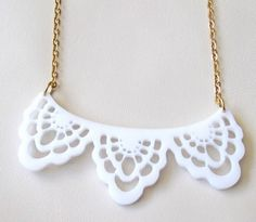 """Exclusive White Lace Necklace   Stunning laser-cut necklace made from white acrylic,  It comes on a gold plated Tiny Round delicate Cable Chain   The necklace total measure approx: 18"""" (45cm)(with the pendant).  The pendant measures approx 3.2"""" (8 cm) in length. lightweight yet substantial.  All of my jewelry comes with a gift box.   $39.9"""