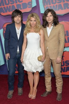 Neil Perry, Kimberly Perry, and Reid Perry of The Band Perry attend the 2014 CMT Music awards in Nashville, Tennessee. via StyleList