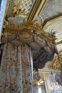Marie's canopy bed at the Palace of Versailles, France