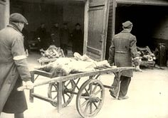 Warsaw, Poland, A cart conveying bodies in the ghetto. 12954886292523366086.JPG