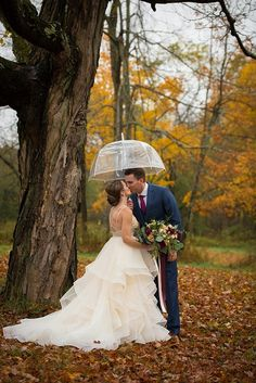 Romantic kiss under an umbrella on a beautiful autumn day | Mike B. Photography on @mtnsidebride via @aislesociety