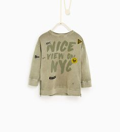 Image 1 of Sweatshirt with patches and rips from Zara