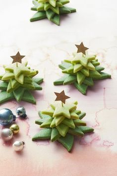 Christmas Tree Stacks Recipe: Layering stars in an ombré pattern gives ordinary tree cookies extra dimension.
