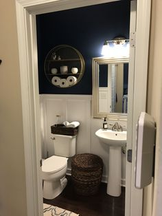 Powder room remodel! Board and batten, navy and white, gold and silver touches. #GoldandSilver