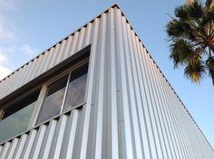 Metal Siding with wood grain finish . Steelogic.com Urbanscape ...
