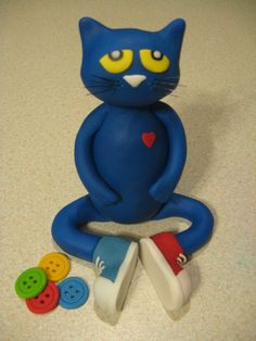 Pete the Cat & his groovy buttons fondant cake topper.  I almost don't want to give him to my friend who ordered him.....lol