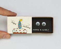 "This listing is for one matchbox. This is a great alternative to a Birthday card. Surprise your loved ones with a cute private message hidden in these beautifully decorated matchboxes!  Each item is hand made from a real matchbox(*). The designs are hand drawn, printed on paper and then hand colored in to give each individual matchbox that special personalized touch. Weve found that these matchboxes are the perfect way to brighten someones day :)  Dimensions: 2 1/16 (length) x 1 3/8""…"
