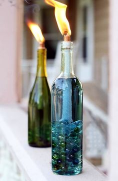 DIY Wine Bottle Citronella Candles (Video) Replace your old, weathered tiki torches with beautiful, colorful DIY wine bottle citronella candles. Empty Wine Bottles, Wine Bottle Candles, Glass Bottles, Wine Bottle Glasses, Liquor Bottles, Glass Bottle Crafts, Diy Bottle, Bottle Art, Alcohol Bottle Crafts