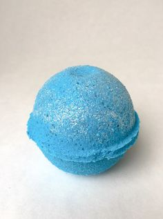 Super sparkly blue raspberry scented glitter bath bomb. These bath bombs are so fun to watch in the water. They turn your water into a sparkly blue