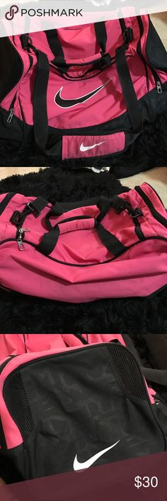 Women's pink Nike athletic bag shoulder bag Only used a couple of times for cheer competitions! Very spacious and super cute pink color. Two large side pockets with shoulder and double strap hand straps! Make me an offer! Nike Bags Travel Bags