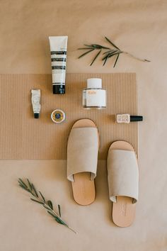 Tammie Joske: Minimalist flat lay featuring St Agni slides, Commodity perfume, Aesop, Grown Alchemist & Kester Black.