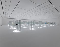 Kanazawa World Craft Triennial 2010 by Nendo. The cases are actually off-the-shelf mini greenhouses, already wired for lighting.