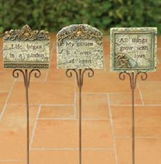 """3 PACK - DELUXE INSPIRATIONAL GARDEN MESSAGE STAKES . $12.94. """"Life began in a garden"""". Approx measurements: 11.0""""H x 0.5""""w x 4.0""""D. """"My garden is a work of heart"""". """"All Things Grow With Love"""". 3 Garden Favorites!. New! Resin Inspirational garden message stakes, 3 styles, as shown.  11.0""""H x 0.5""""w x 4.0""""D. Save 13% Off!"""