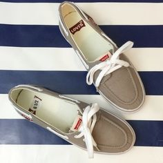 NWOT Canvas Lace Ups Modern boat deck sneakers. A few minor scuffs, but no rips, or stains. Price firm unless bundled. Levi's Shoes Sneakers