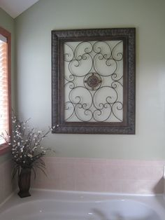 Wrought iron art work above the jacuzzi tub. Perfect for couples bathroom...not too masculine and not too feminine.