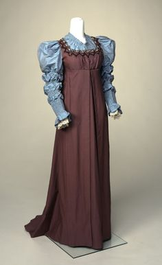 Dress (Reform) Date: ca. 1890–1895 Media: Wool Challis And Silk Taffeta Country: United States Accession Number: 59.48.13 'Jumper' style highwaisted dress. Yoke and puffed long sleeves of pink-shot aqua silk taffeta. Dress of puce-colored wool challis trimmed around yoke with large burgundy/white ricrac. Bodice opens CF, skirt left front. Long flared and trained skirt.